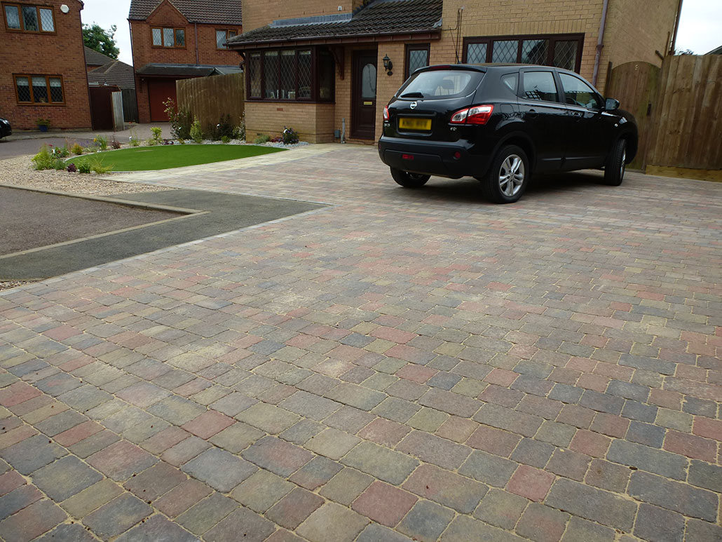 coloured driveway with planting area
